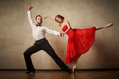 Ballet dancer and latin dancer mix the styles together. Stock Photography