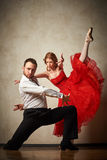 Ballet dancer and latin dancer mix the styles together. Stock Photos