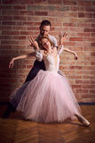 Ballet dancer and latin dancer mix the styles together. Stock Photo