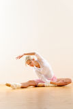 Ballet dancer in leaning posture exercise studio Royalty Free Stock Photos