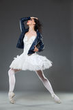 Ballet dancer in a leather jacket Stock Images