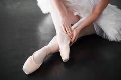 Ballet dancer legs in pointe shoes closeup Stock Photo