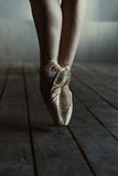 Ballet dancer legs standing on the tiptoes in pointes Royalty Free Stock Images