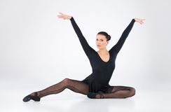 Ballet dancer lifted hands in air Stock Photo