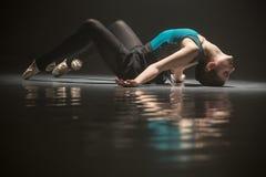 Ballet dancer lying on the floor Stock Photo