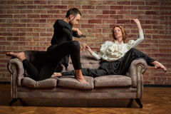 Ballet dancer and male latin dancer in contemporary style. Female ballet dancer and male latin dancer in contemporary style drinking champagne Royalty Free Stock Photography