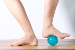 Ballet dancer massaging her foot. Close up low section of ballet dancer massaging her foot Stock Photos