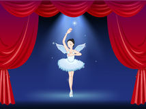 A ballet dancer in the middle of the stage Royalty Free Stock Photo