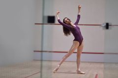 Ballet dancer. Modern style ballet dancer woman posing and jumping on training in gym royalty free stock photography