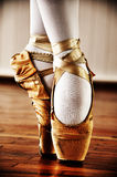 Ballet dancer. With golden shoes royalty free stock images