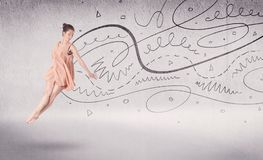 Ballet dancer performing art dance with lines and arrows. Ballet dancer performing art dance with hand drawn lines and arrows concept on background Royalty Free Stock Photography