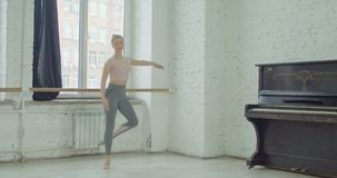 Ballet dancer performing failli jump exercise. Charming graceful ballerina rehearsing in ballet studio, performing failli exersice. Elegant classic ballet dancer stock video