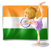 A ballet dancer performing in front of the Tajikistan flag Royalty Free Stock Image