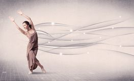 Ballet dancer performing modern dance with abstract lines royalty free stock photo