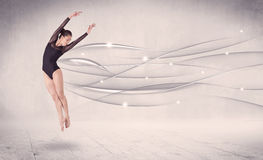 Ballet dancer performing modern dance with abstract lines Stock Photography