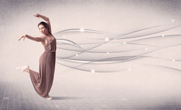 Ballet dancer performing modern dance with abstract lines Royalty Free Stock Images