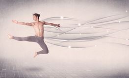 Ballet dancer performing modern dance with abstract lines Stock Photo