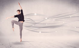 Ballet dancer performing modern dance with abstract lines Royalty Free Stock Image