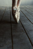 Ballet dancer performing on tiptoes in pointes Stock Images