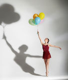 Ballet dancer posing with ballons Stock Photo