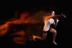 Ballet dancer posing on black studio background Stock Photography