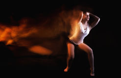 Ballet dancer posing on black studio background Stock Photos