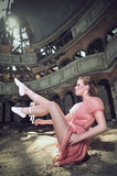Ballet dancer posing on church Stock Photography