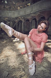 Ballet dancer posing on church Stock Images