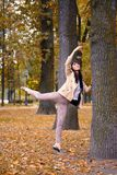 Ballet dancer posing in a garden the city of St. Petersburg Royalty Free Stock Photo