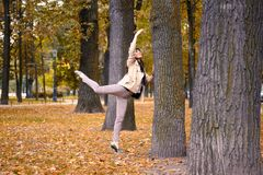 Ballet dancer posing in a garden the city of St. Petersburg Stock Photos