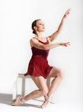 Ballet dancer posing on studio background Stock Images