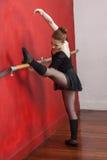 Ballet Dancer Practicing At Handrail In Studio. Full length of female ballet dancer practicing at handrail in dance studio stock images