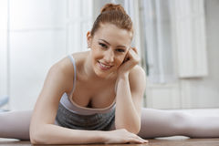 Ballet Dancer Practicing While Sitting On Floor Royalty Free Stock Images