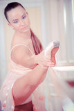 Ballet dancer practicing a stretch Royalty Free Stock Photos