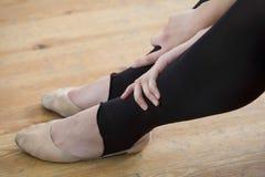 Ballet Dancer Relaxing On Wooden Floor Royalty Free Stock Photography