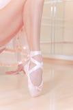 Ballet dancer's feet on wooden floor Royalty Free Stock Image