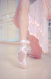 Ballet dancer's feet on wooden floor Stock Photography
