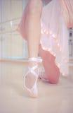 Ballet dancer's feet on wooden floor Stock Photography