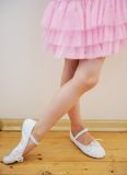 Ballet dancer's legs and feet in pink tutu dress Royalty Free Stock Images