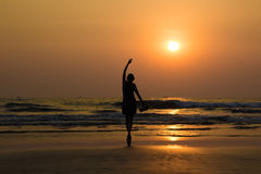 Ballet dancer's silhouette by the sea in sunset light in Arambol Royalty Free Stock Photography