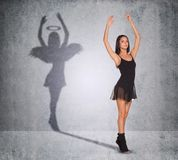 Ballet dancer with shadow showing angel side Stock Image