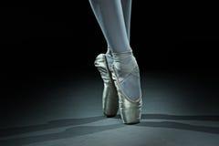 Ballet dancer shoes - gold Stock Photos