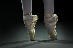 Ballet dancer shoes - gold Stock Image