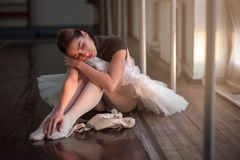Ballet dancer sitting on the floor after rehearsal Royalty Free Stock Images