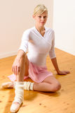 Ballet dancer sitting on the studio floor Stock Photo