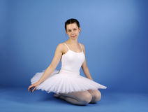 Ballet dancer sitting in white tutu Royalty Free Stock Photos