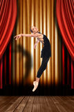 Ballet Dancer on Stage With Drapes. Female Ballet Dancer on Stage With Drapes Royalty Free Stock Photos