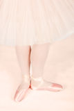 Ballet dancer standing on peach floor while dancing artistic con Stock Photo