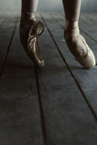 Ballet dancer standing on the tiptoes and stretching Stock Photography