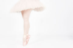 A ballet dancer standing on toes while dancing artistic conversi Stock Photography